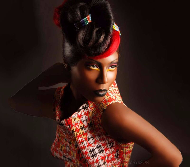 Colourful look for black skin and hair by creative makeup artist Fiona Tanner South East London