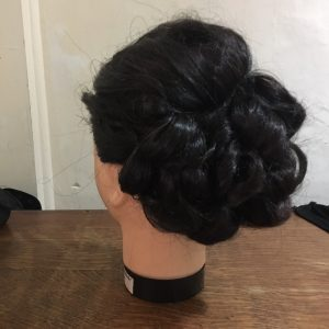 Contemporary bridal up do by FTMakeup