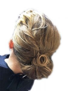Hair up tousled with twists