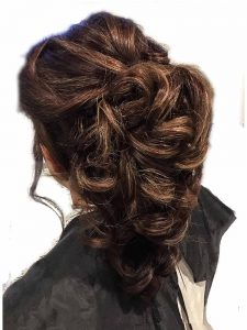 Tumbling glamorous ponytail up do