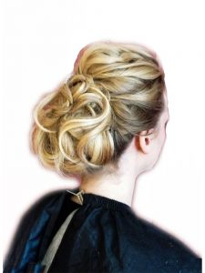 Twisted up do with coiled locks