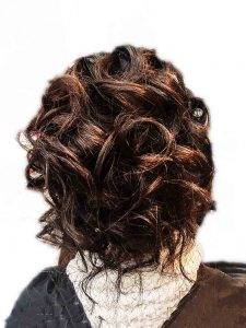twisted soft romantic tumbling up do